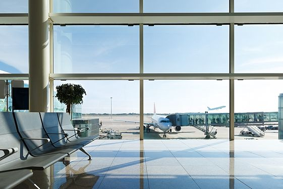Airport waiting room with view of planes taking off